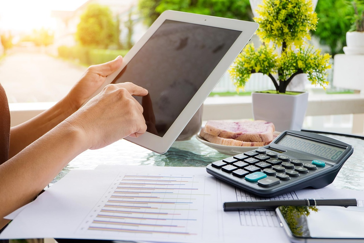 Image of ipad, calculator and accounting documents