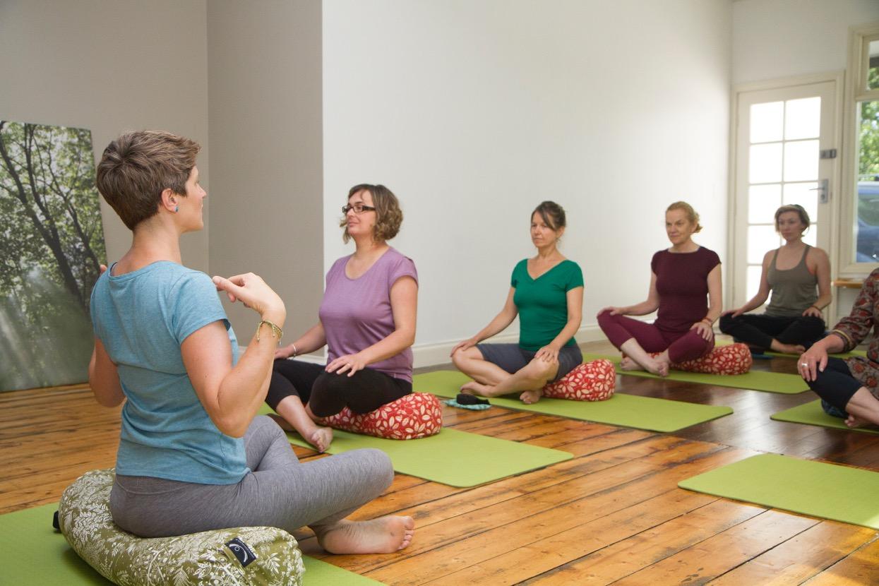 sitting in yoga class