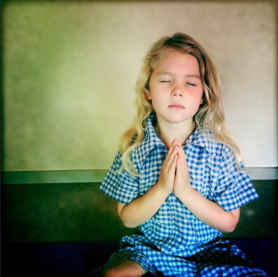An image of a child practicing yoga